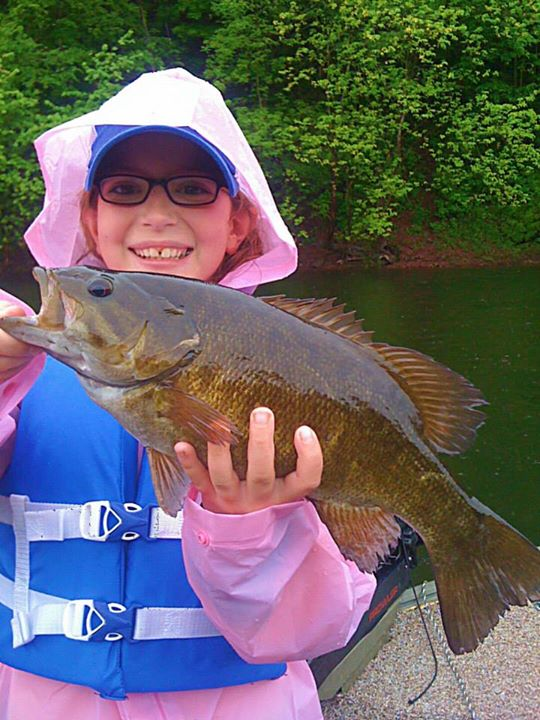 "Fishing Jeff shauf reports:  ""My daughter madisyn shauf with her biggest smallie to date. She thought her black and blue yum tube was stuck but to her surprise the rock she thought she had fought back :)"""