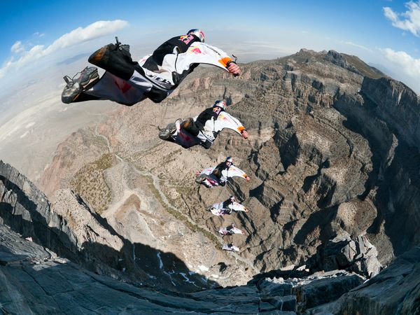 Extreme A Red Bull Air Force Team member BASE jumps off a cliff in southwestern Utah
