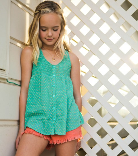 Surf O'Neill Girls Treat Top.  100% Rayon gauze printed.  Saddle cut along bottom opening; smocking detail along front and back; front placket with buttons; metal logo badge. - $36.00