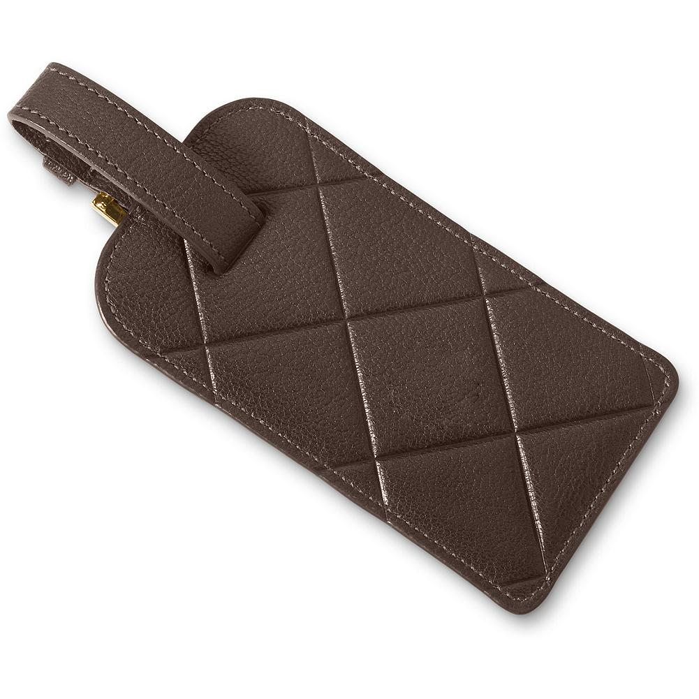 Entertainment Eddie Bauer Leather Luggage Tag - These handsome luggage tags are made of full-grain leather and detailed with our signature diamond-quilt pattern. A special flap conceals personal information. Secure buckle attachment. - $9.99