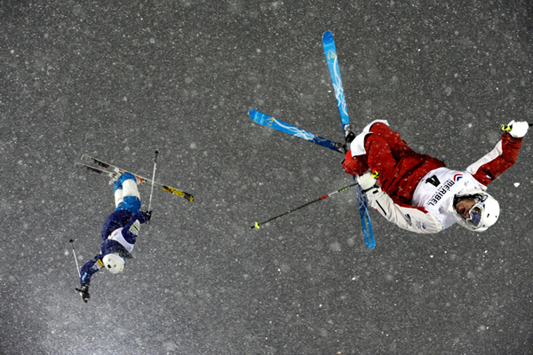 Ski Denis Dolgodorov of Russia and Mikael Kingsbury of Canada compete during the FIS Freestyle Ski World Cup Dual Moguls in Méribel, France