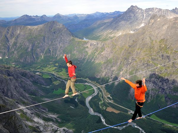 Climbing Julien Millot (right) and Alexander Lauterbach highlining the Trollveggen, Norway
