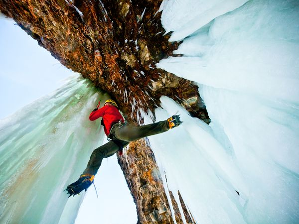 Climbing Craig Pope crossing from an ice cave to a free-standing, 82-foot-tall icicle—without ropes or protection in Banks Lake, Washington