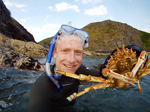 Scuba Alastair Humphreys snorkels to catch spider crabs to cook for dinner on a backyard adventure in nearby Pembrokeshire, Wales
