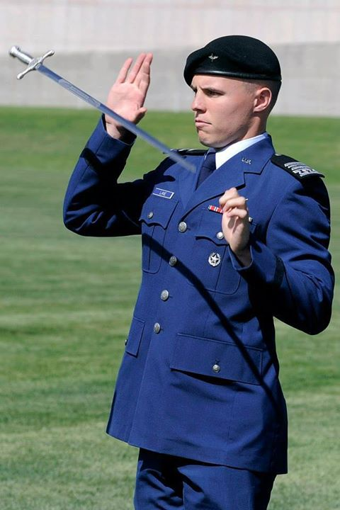 Guns and Military How would you caption this photo of Cadet 1st Class Josiah Lane from the US Air Force Academy (Official) Sabre Drill Team?