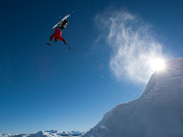 Ski Picture of Josh Dueck performing the worlds first sit ski, backflip