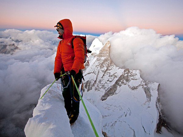 Climbing Picture of Renan Ozturk at the summit of Meru