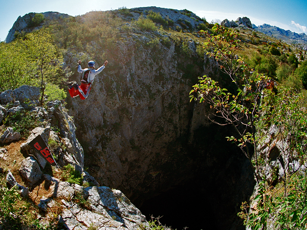 Extreme Picture of Felix Baumgartner BASE jumping into Mamet Cave