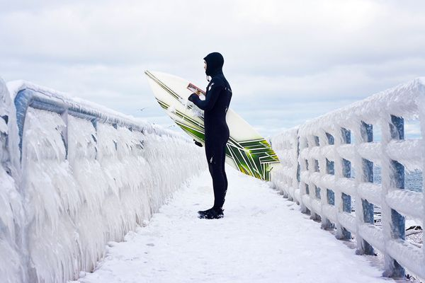 Surf Surfer on frozen pier, Lake Michigan, Indiana