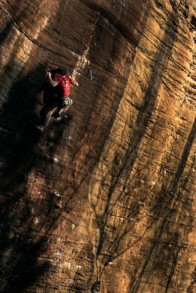 Climbing Climber on mountain face in Red River Gorge Kentucky