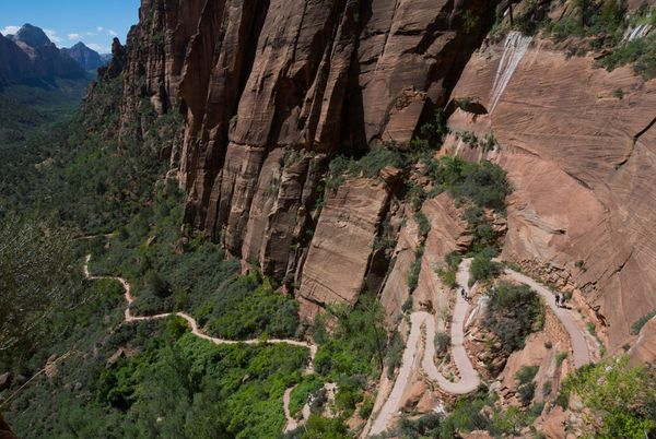 Camp and Hike Picture of hikers on a winding mountain trail in Zion National Park