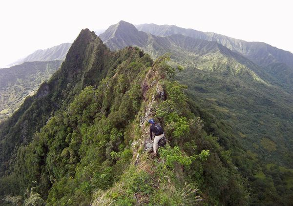 Camp and Hike Picture of a man hiking up the side of mountain, Hawaii