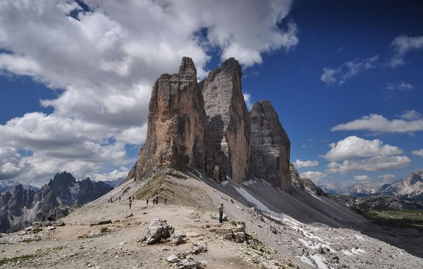 Camp and Hike Picture of hikers approaching Tre Cime di Lavaredo, Italy