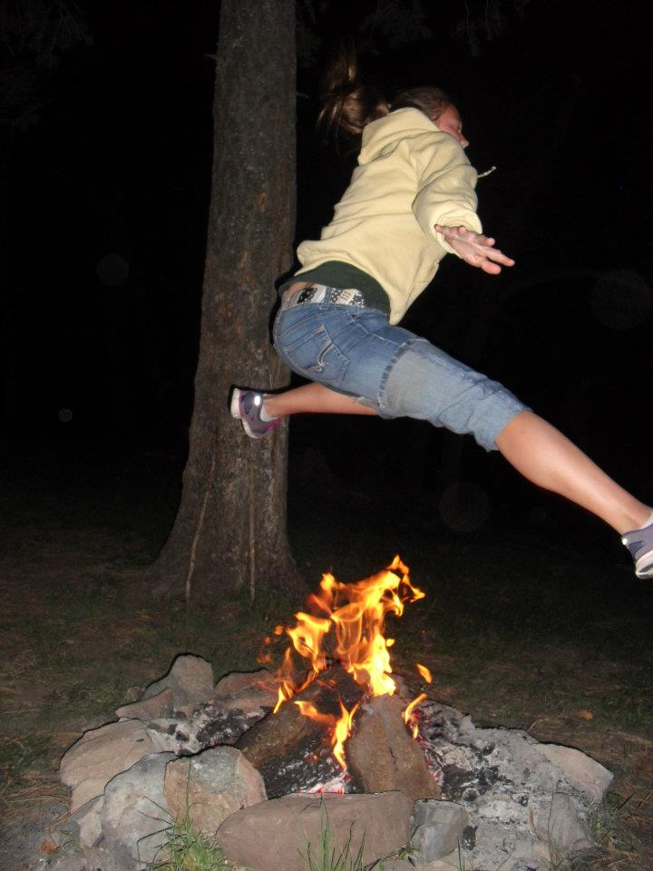 Camp and Hike leaping over fire