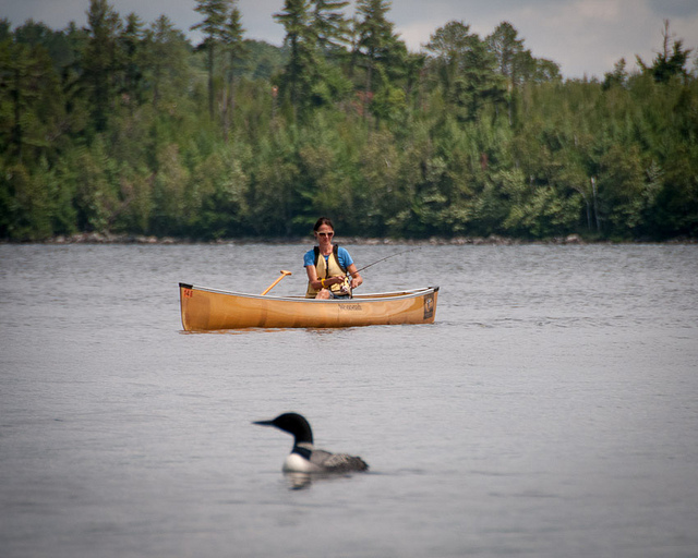 Fishing ishing from her solo canoe
