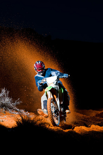 Motorsports Jorge Visser throwing up an arc of red sand in the Utah Desert near his home.