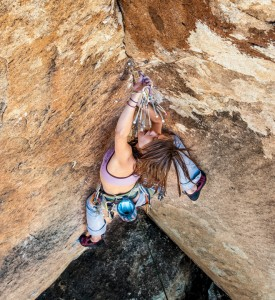 Climbing Nicky Dyal experiments with nut placements on Scary Monsters (5.12a), Joshua Tree, California
