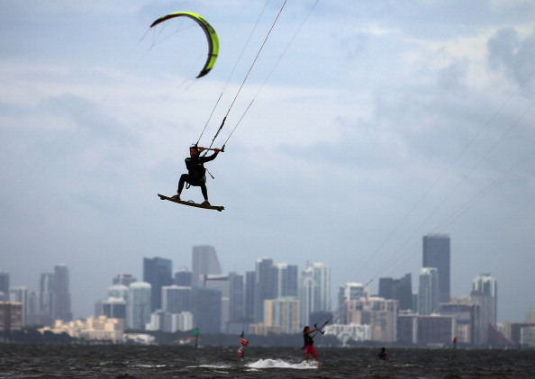 Surf Santiago Porteiro takes advantage of the winds from the outerbands of Hurricane Sandy to kite surf on October 24, 2012 in Miami, Florida.