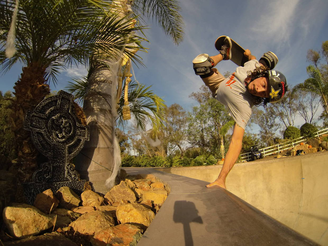 Skateboard Bucky Lasek messing around in his backyard bowl with the HERO3 and a WiFi remote!