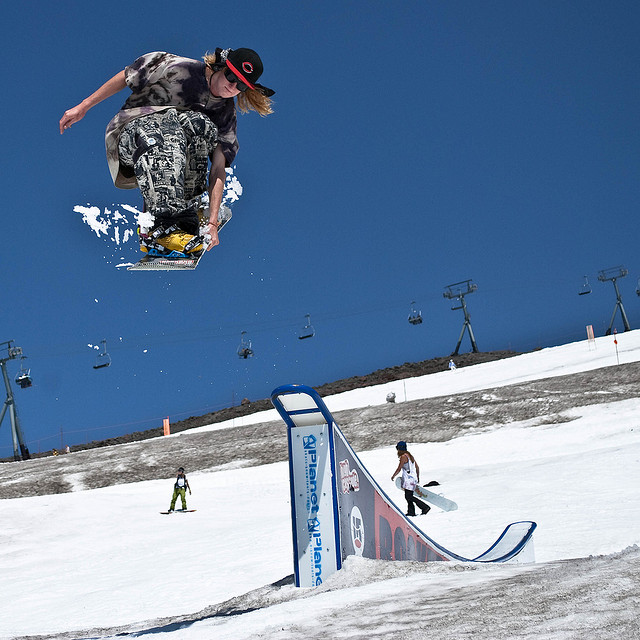 Snowboard Alex Kevesdy with the tuck knee