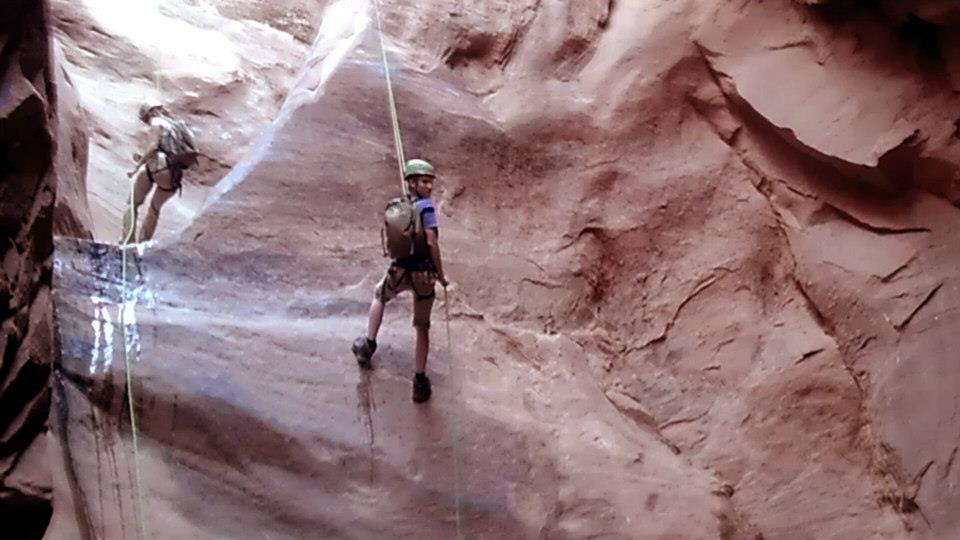 Climbing My brother tom on his 2nd rappel into  Ephedras Grotto Canyon