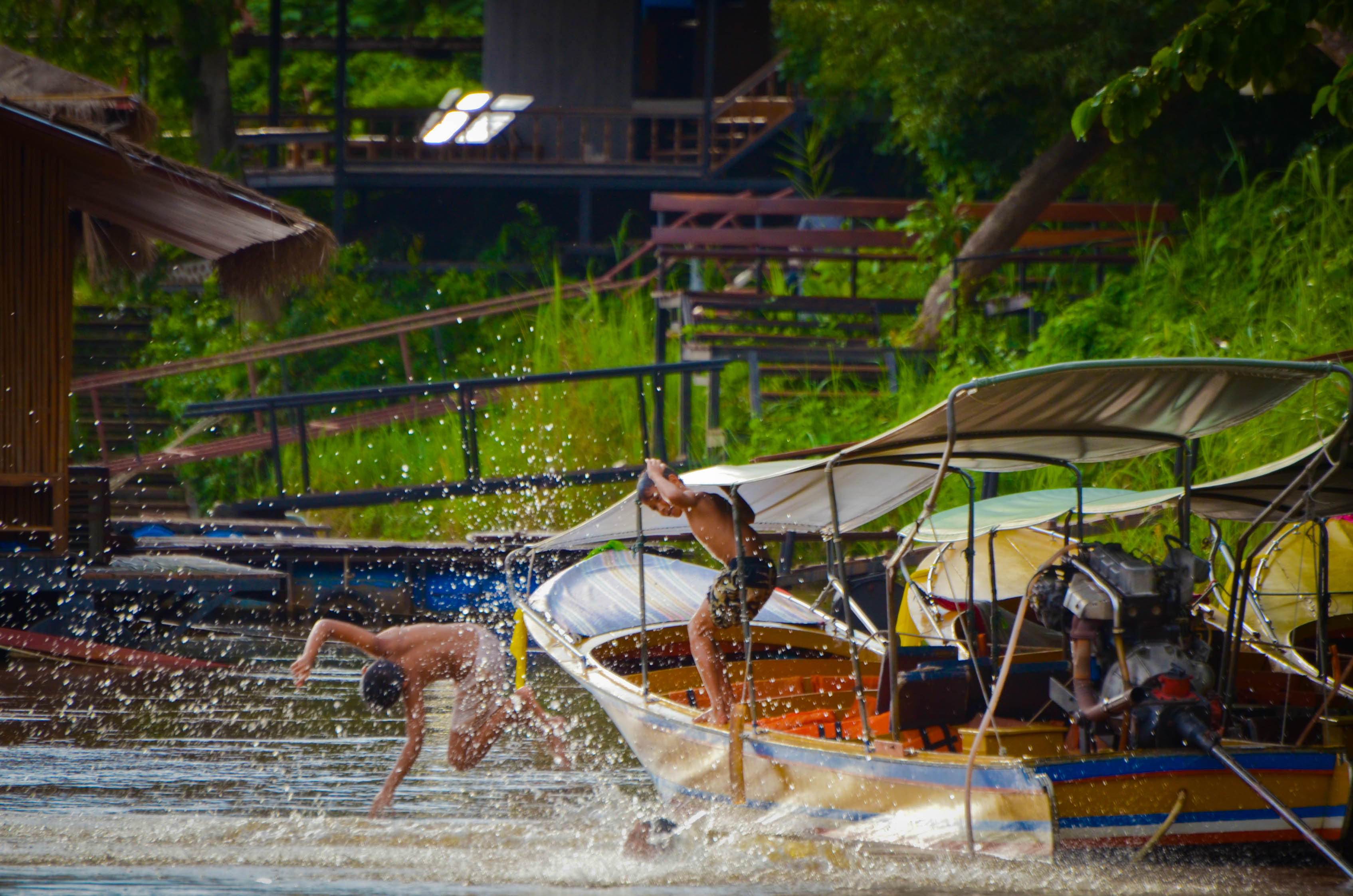 Entertainment Kids jumping into the River Kwai, Thailand
