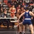High School wrestler disqualified after punching opponent, pushing him into scorer's t...