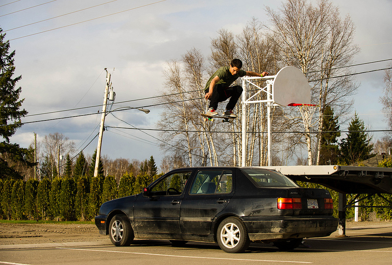 Skateboard  jump over the Jetta