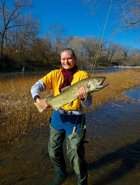 Flyfishing Karen Campbell and a Milwaukee River king salmon
