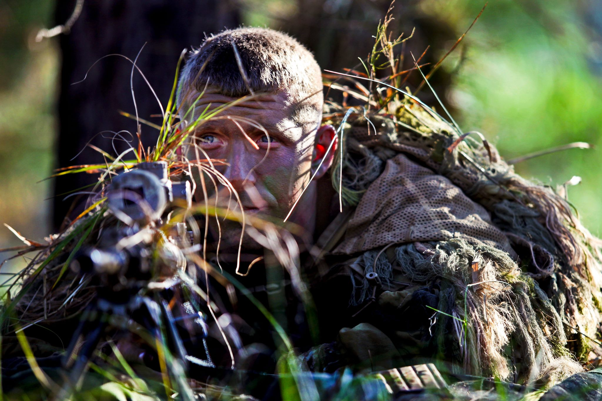 Guns and Military Army Staff Sgt. Mathew Fox, 3rd Infantry Division, waits to engage a target in the live-fire stalk event during the 2012 International Sniper Competition at the U.S. Army Sniper School on US Army Fort Benning Nov. 3.