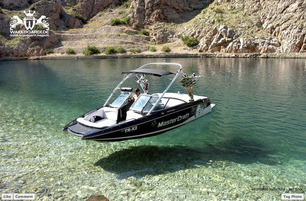 Wake Boats in crystal clear water look as if they float in the air