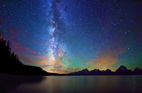 Camp and Hike The Milky Way over Jackson Lake and Tetons at Grand Teton National Park in Wyoming