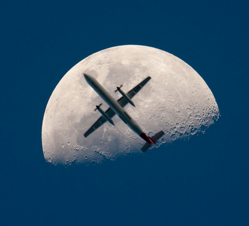 Entertainment  In this perfectly timed photograph by Chris Thomas, we see an airplane passing directly in front of the Earth's moon.
