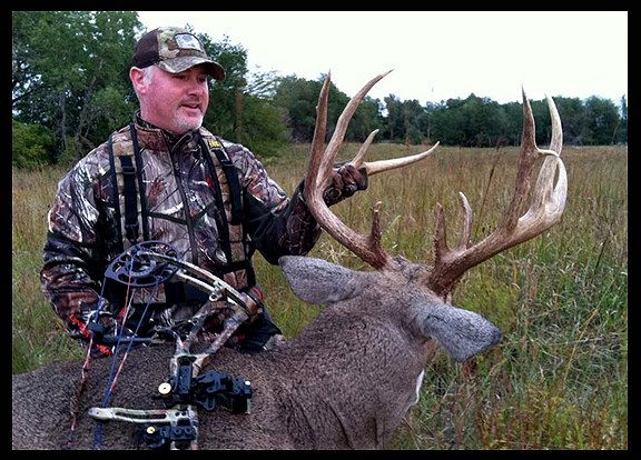 "Hunting Jeff Danker of Major League Bowhunters with his 183 and 5/8"" Kansas whitetail."