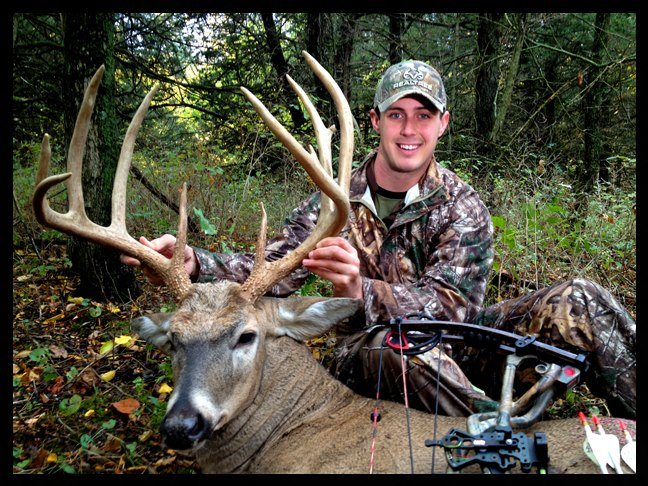 "Hunting Realtree's Tyler Jordan scored on a great 170"" buck while hunting with Tiffany and Lee Lakosky in Iowa Friday morning (10-5-12). It was Tyler's third day of the hunt and took a 50-yard shot with his Hoyt Element."