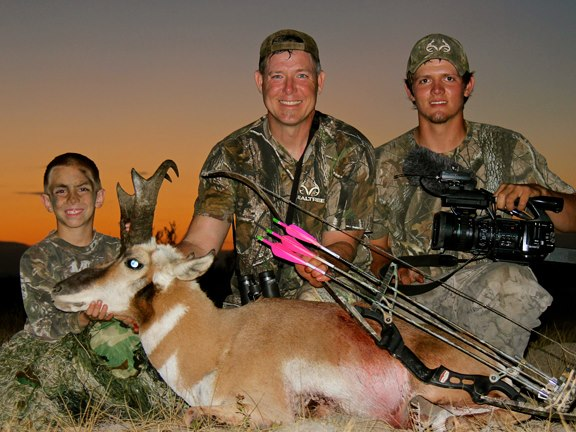 Hunting Fred Eichler of Easton Bowhunting TV with his son Trent (left) and cameraman Lane (right) after Fred's successful treestand hunt for an antelope.