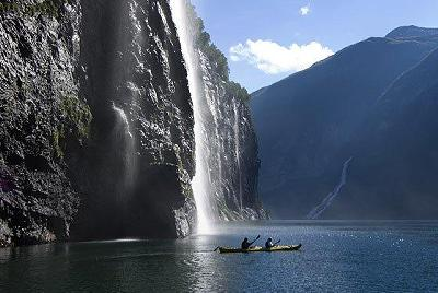 Kayak and Canoe Kayaking to a Norway Waterfall