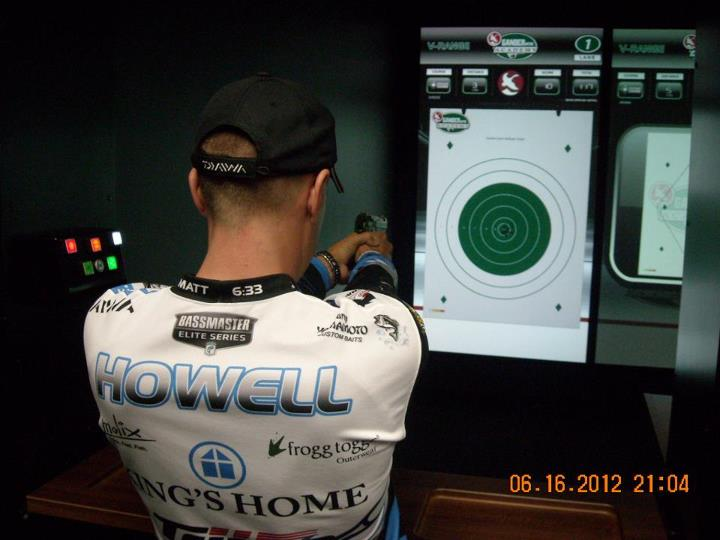 Randy Howell testing out the shooting range simulator in the Gander Mountain Academy