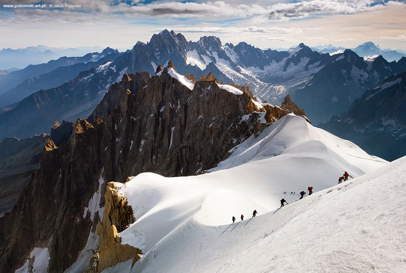 Camp and Hike THE ALPINISTS Photograph by Jakub Polomski on 500px In this incredible capture by Jakub Polomski, we see a group of Alpinists making their way to the top of Aiguille du Midi (3,824m/12,605 ft), a mountain in Chamonix (French Alps) and the starting point f