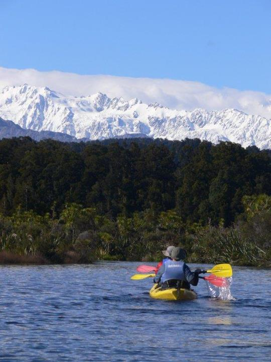 Kayak and Canoe For Travel Tuesday today, we're daydreaming about kayaking the Okarito Lagoon, on the West Coast of the South Island of New Zealand like these REI Adventures trip participants.  Those are the Southern Alps in the background.  Okarito Lagoon is the largest
