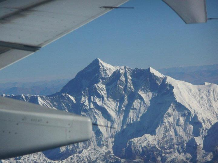 Climbing One of our REI Adventures staffers snapped this beauty during October of 2008 on a flight from Paro, Bhutan to Kathmandu, Nepal when traveling between our Chomolhari Trek and our Nepal's Royal Trek.  Himalayan buffs -- that's Mount Everest out the plane w