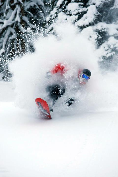 Snowboard Josh Dirksen enjoying a face full of British Columbia pow.  Photo by Adam Clark