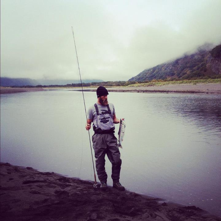 Flyfishing Keith Malloy with his first silver salmon.  Photo by Foster Huntington