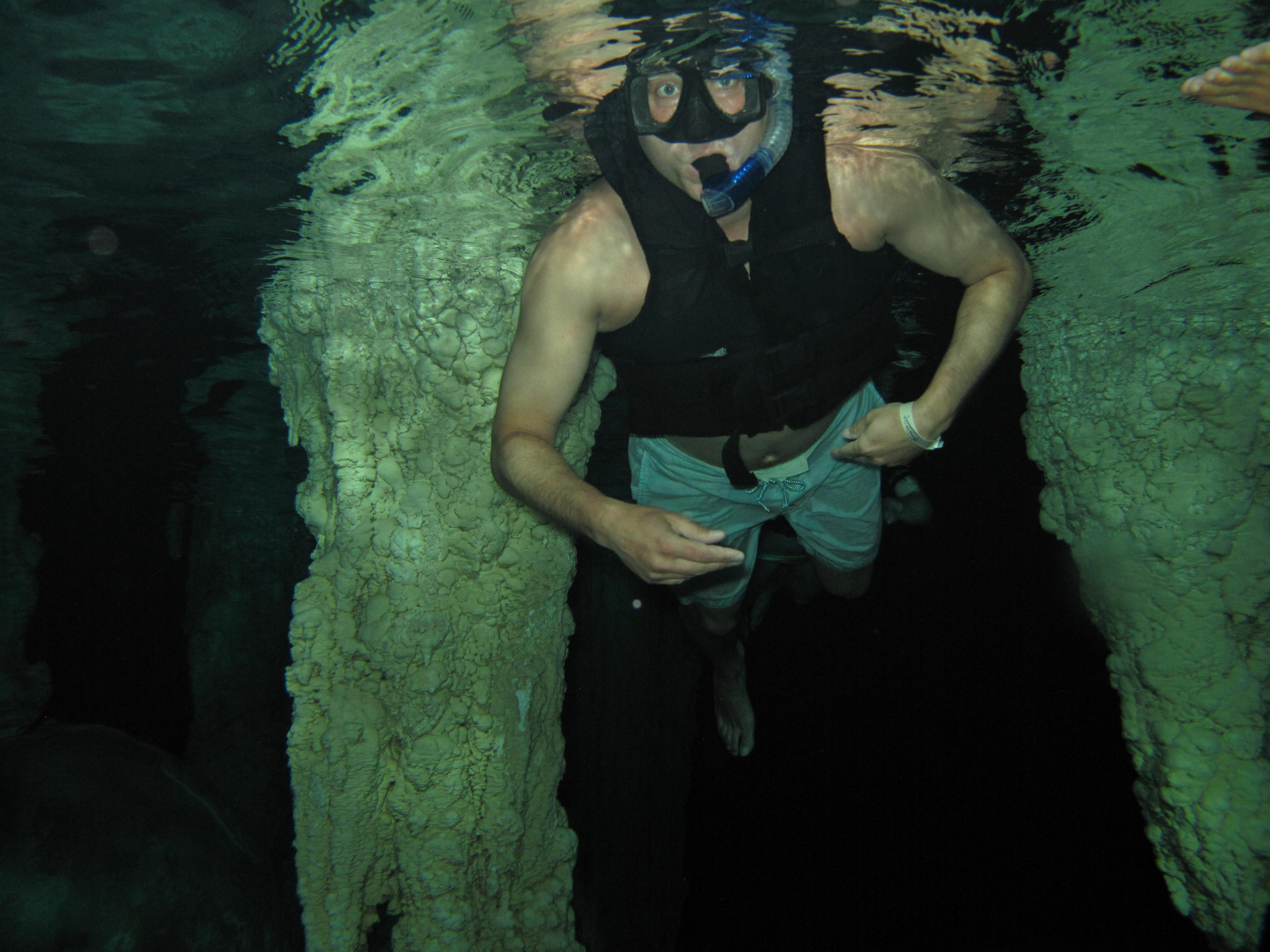Scuba Swimming in Caves of Mexico