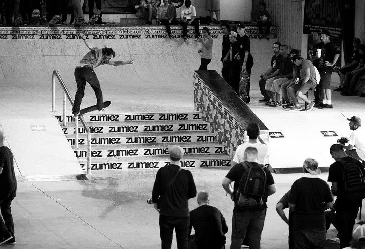 Skateboard DC SKATEBOARDING's Evan Smith back tails for the rail during the Zumiez Best Trick contest.
