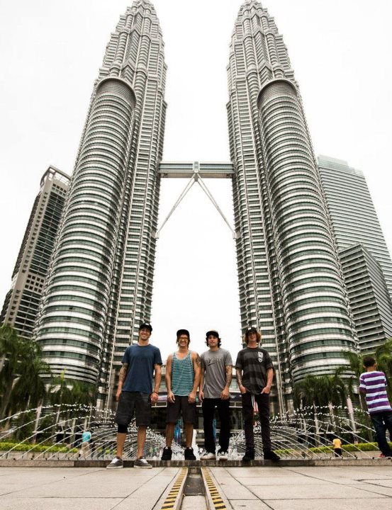 BMX Rob Wise, Dylan Stark, Alfredo Mancuso, and Jeremiah Smith posing infront of the Petronas Towers in Malaysia.