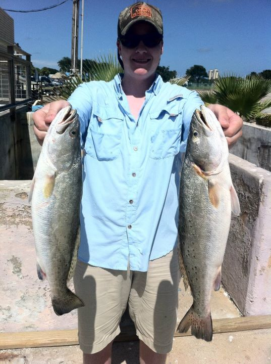Fishing Trevor Calvin showing off his Speckled Trout caught on Galveston Bay!