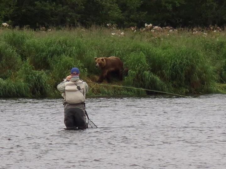 Flyfishing Here's our 1st place winner from the WOS Photo Contest! WOS fan Scott came face-to-face with a bear when fly-fishing in Kamchatka, Russia. AWESOME shot!