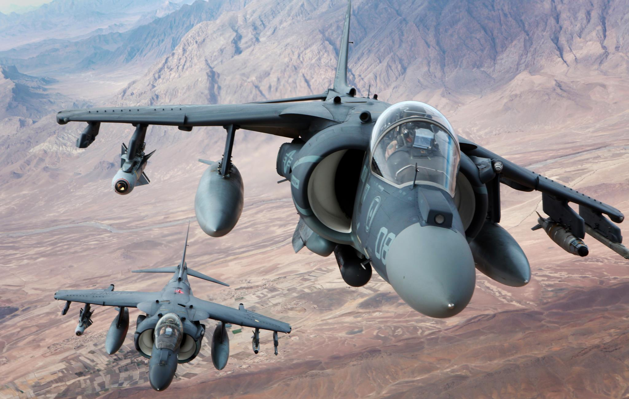 Guns and Military Capt. Jonathan Lewenthal and Capt. Eric Scheibe, AV-8B Harrier pilots with Marine Attack Squadron 231, Marine Aircraft Group 14, 3rd Marine Aircraft Wing (Forward), fly over southern Helmand province, Afghanistan after conducting an aerial refuel Dec. 6,