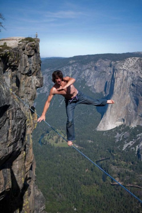 Extreme Dean Potter highlining at Taft Point in Yosemite Valley. Photo by Jeff Cunningham